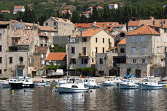 fisherman-village-komiza-vis-island-croatia-little-fishing-boats-anchored-harbor-31125853