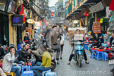 old-quarter-hanoi-vietnam-february-woman-transports-huge-load-motorbike-there-approximately-four-51632464