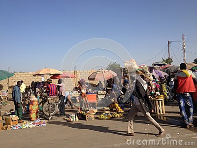 street-market-n-djamena-chad-tropics-boy-barca-shirt-merchant-carrying-his-merchandise-his-head-woman-selling-57819111
