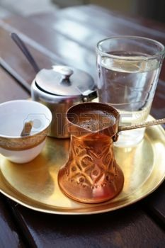 13273297-turkish-coffee-served-in-a-traditional-turkish-metal-dish-cap